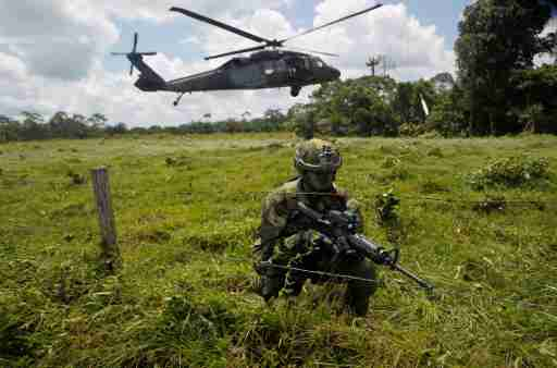 A Colombian soldier watches over the border with Ecuador in Narino, Colombia April 18, 2018. REUTERS/Fredy Builes - RC1682927870