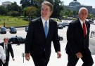 With the U.S. Supreme Court building in the background, Supreme Court nominee judge Brett Kavanaugh arrives with U.S. Vice President Mike Pence prior to meeting with Senate Majority Leader Mitch McConnell on Capitol Hill in Washington, U.S., July 10, 2018. REUTERS/Joshua Roberts - RC1165F1B5C0