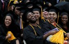 Graduating students of the City College of New York laugh together during the College's commencement ceremony in the Harlem section of Manhattan, New York, U.S., June 3, 2016. REUTERS/Mike Segar - D1BETHVBPRAA