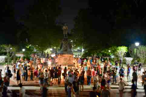 Charlottesville community members leave candles and flowers at the base of a statue of Thomas Jefferson north of University of Virginia's Rotunda at a vigil for Heather Heyer following last Saturday's protest organized by white nationalists that turned deadly in Charlottesville, Virginia, U.S. on August 16, 2017. Picture taken on August 16, 2017.   Courtesy Tim Dodson/The Cavalier Daily/Handout via REUTERS   ATTENTION EDITORS - THIS IMAGE WAS PROVIDED BY A THIRD PARTY. MANDATORY CREDIT. - RC161271C8B0