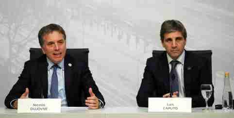 Argentina's Treasury Minister Nicolas Dujovne speaks next to Central Bank President Luis Caputo
