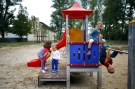 "Four-year old Tom (R) and his six-year old sister Lisa from Offenbach show Serbian refugee Dragan (2nd L) and his sister Tamara (L) how to play on the climbing frame at a refugee camp in Hanau, Germany, August 18, 2015. Tom and Lisa learned from her mother that a lot of refugees come to Germany and most of them, especially the children, don't have much clothes or toys to play with. The two German youngsters than decided to visit the refugee camp to donate from their own wardrobe and toys and ""make friends"" with the kids from abroad.   REUTERS/Kai Pfaffenbach  - GF10000175689"