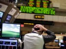 A trader works on the floor of the New York Stock Exchange August 4, 2011. Investors fled Wall Street in the worst stock-market selloff since the depths of the Great Recession in early 2009 in what has turned into a full-fledged correction. REUTERS/Brendan McDermid (UNITED STATES - Tags: BUSINESS IMAGES OF THE DAY) - GM1E7850E2U01