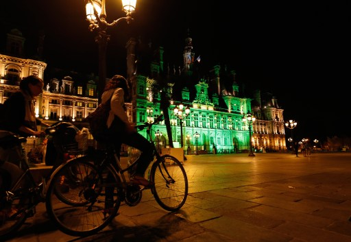 Green lights are projected onto the facade of the Hotel de Ville in Paris, France, after U.S. President Donald Trump announced his decision that the United States will withdraw from the Paris Climate Agreement at a news conference  June 1, 2017. REUTERS/Philippe Wojazer - UP1ED611NP15U