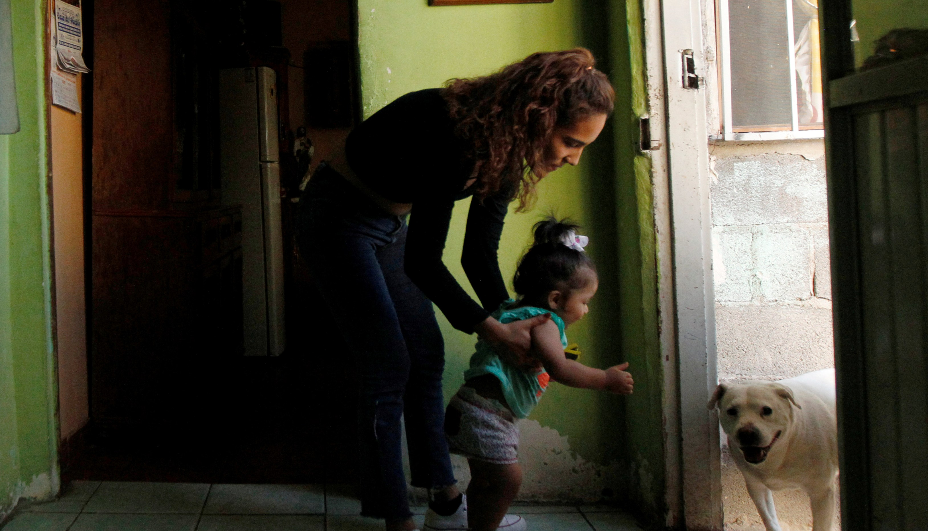 "Fatima Paola Pizarro (L), holds her daughter Aitana Pizarro at her grandparent's home in Ciudad Juarez, Mexico May 8, 2018. Fatima is the daughter of Marcelino Pizarro who lives in El Paso, U.S. REUTERS/Jose Luis Gonzalez   SEARCH ""MARCELINO PIZARRO"" FOR THIS STORY. SEARCH ""WIDER IMAGE"" FOR ALL STORIES. - RC1EC57A0B00"