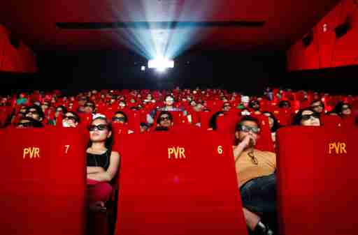 Cinema-goers wearing 3D glasses watch a movie at a PVR Multiplex in Mumbai November 10, 2013. Multiplex operators like PVR Ltd, Inox Leisure, Reliance Mediaworks and Mexican chain Cinepolis are scrambling to set up theatres targeting the rapidly growing number of middle-class Indians willing to pay to watch Bollywood movies in more comfortable surroundings. The potential is huge, provided operators can find the right location in a country where prime urban real estate is costly and in short supply. Picture taken November 10, 2013.       To match MULTIPLEX-INDIA/        REUTERS/Danish Siddiqui (INDIA - Tags: SOCIETY BUSINESS ENTERTAINMENT) - GM1E9BK0DED01