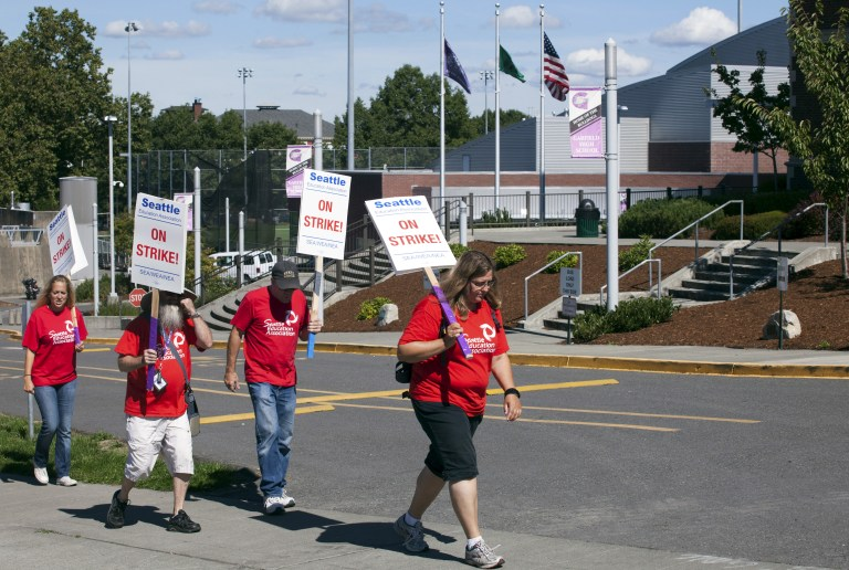 Teachers walk the picket line as they strike outside Garfield High School in Seattle, Washington September 9, 2015. Classes were cancelled for 53,000 students as Seattle teachers and support staff marched in picket lines on Wednesday on what was supposed to be the first day of school, waging their first such strike in three decades after contract talks between the school district and the teachers' union failed. REUTERS/Matt Mills McKnight - GF10000199643