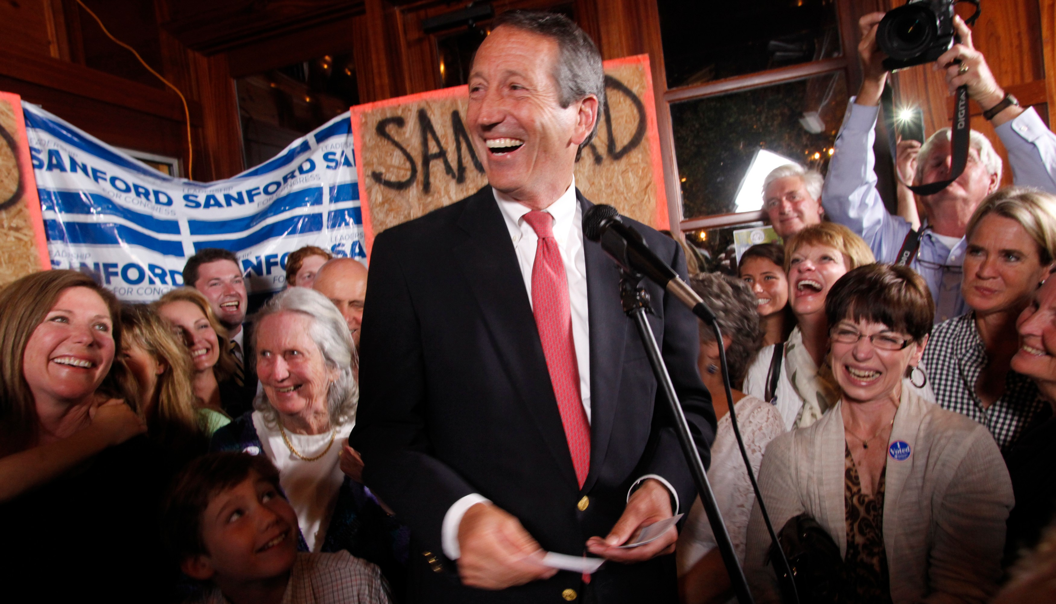 Former South Carolina Governor Mark Sanford celebrates his victory with a large crowd in the South Carolina first district congressional race at Liberty Tap Room in Mount Pleasant, South Carolina May 7, 2013. Republican former Governor Sanford made a political comeback on Tuesday, rebounding from a sex scandal to beat Democrat Elizabeth Colbert Busch in a congressional race to represent coastal South Carolina. REUTERS/Randall Hill  (UNITED STATES - Tags: POLITICS ELECTIONS TPX IMAGES OF THE DAY) - GM1E9580T3T01