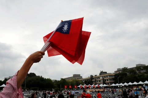 An audience waves Taiwanese flags during the National Day celebrations in Taipei, Taiwan October 10, 2018. REUTERS/Tyrone Siu - RC1A37B136B0
