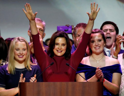 Democratic gubernatorial candidate Gretchen Whitmer reacts with her daughters, Sydney (L) and Sherry after declaring victory at her midterm election night party in Detroit, Michigan, U.S. November 6, 2018. REUTERS/Jeff Kowalsky - RC193ED6A9B0