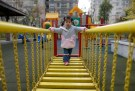 "A child walks on a swinging bridge at a kindergarten in Wuhan, Hubei province, December 3, 2012. Expectations are now high that China could relax the one-child policy, or even implement a universal two-child policy such as the one in Jiuquan. Outgoing President Hu Jintao, for the first time, conspicuously dropped the phrase ""maintain a low birth rate"" in his work report to the Chinese Communist Party's twice a decade congress in November. That foreshadows a change to the one-child ethos, according to Ji Baocheng, a delegate to China's rubber stamp parliament who has petitioned five times for a change in the policy. Picture taken December 3, 2012. REUTERS/Stringer (CHINA - Tags: POLITICS SOCIETY EDUCATION) CHINA OUT. NO COMMERCIAL OR EDITORIAL SALES IN CHINA - GM1E91M0E8Y01"