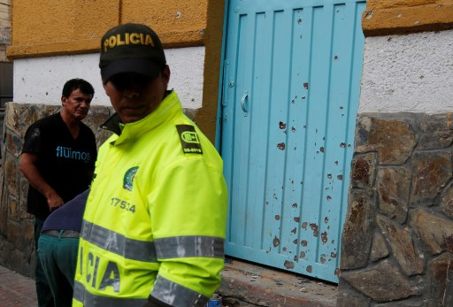 A police officer works the scene where an explosion occurred near Bogota's bullring, Colombia, February 19, 2017. REUTERS/Jaime Saldarriaga - RC16A8416680