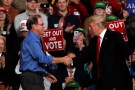 U.S. President Donald Trump shakes hands with Republican candidate for U.S. Senate Mike Braun during a campaign rally at Southport High School in Indianapolis, Indiana, U.S. November 2, 2018.  REUTERS/Carlos Barria - RC1E86AB4B90