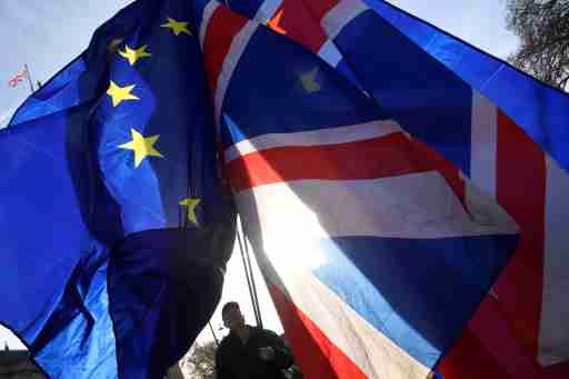 Demonstrators hold EU and Union flags during an anti-Brexit protest opposite the Houses of Parliament in London, Britain, December 17, 2018. REUTERS/Toby Melville - RC14C86B4D80
