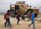 Syrian schoolchildren walk as U.S. troops patrol near Turkish border in Hasakah, Syria November 4, 2018. REUTERS/Rodi Said - RC11C2532E70