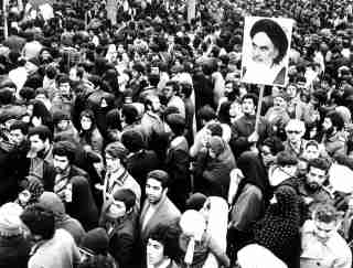FILE PHOTO OF FEBRUARY 1979 - Supporters of the leader and founder of the Islamic revolution Ayatollah Khomeini hold his picture in Tehran during the country's revolution in February 1979. Iraninans celebrate the 20th anniverssary of the Revolution this week.DS/WS - RP1DRIHULAAA