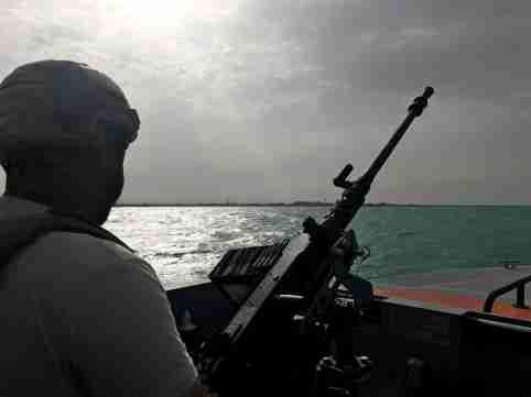 UAE navy soldier patrols at Al-Mokha port in Yemen