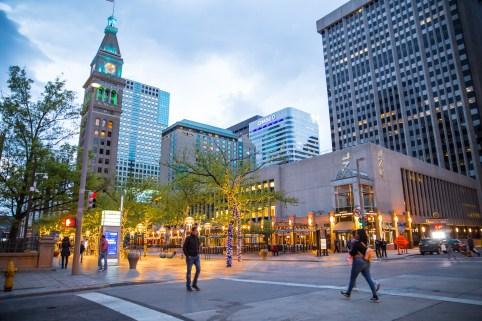 Pedestrians walk in Denver