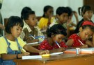Young Nicobarese tsunami survivors study in a classroom in a relief camp in Port Blair, the capital of India's Andaman and Nicobar archipelago January 13, 2005. [India, which had shunned foreign help for its tsunami victims, has now allowed UNICEF to help mount a campaign in the battered Andaman and Nicobar islands to prevent an outbreak of measles and blindness among children.] - PBEAHUODMFX