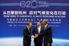 Chinese President Xi Jinping (C), UN Secretary General Ban Ki-moon and U.S. President Barack Obama (R) shake hands during a joint ratification of the Paris climate change agreement ceremony ahead of the G20 Summit at the West Lake State Guest House in Hangzhou, China on September 3, 2016. REUTERS/How Hwee Young/Pool/File Photo - TM3ECBA1TEJ01