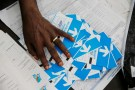 An official from Congo's Independent National Electoral Commission(CENI) counts presidential elections ballots at tallying centre in Kinshasa, Democratic Republic of Congo, January 4, 2019. REUTERS/Baz Ratner - RC168E05A470
