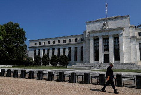 A person walks past the Federal Reserve building in Washington, U.S., July 16, 2018. REUTERS/Leah Millis - RC15C50746E0