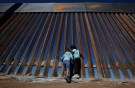 Children play at a newly built section of the U.S.-Mexico border wall at Sunland Park, U.S. opposite the Mexican border city of Ciudad Juarez, Mexico November 18, 2016. Picture taken from the Mexico side of the U.S.-Mexico border. Picture taken November 18, 2016. REUTERS/Jose Luis Gonzalez - RC13C47E2660