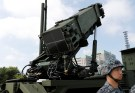 A Japan Self-Defense Forces (JSDF) soldier stands in front of Patriot Advanced Capability-3 (PAC-3) missile unit before Japan's Chief Cabinet Secretary Yoshihide Suga reviews the unit at the Defense Ministry in Tokyo, Japan, October 8, 2017. REUTERS/Kim Kyung-Hoon - RC1B33E78DD0