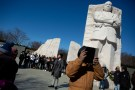 "Brandon Stanard, 24, a student at Lincoln University, recites Martin Luther King, Jr.'s ""I have a dream"" speech to a gathering crowd at the base of a statue of the civil rights leader at the Martin Luther King, Jr. Memorial on Martin Luther King Jr. Day in Washington, U.S., January 21, 2019. REUTERS/Allison Shelley     TPX IMAGES OF THE DAY - RC1FB437CDE0"