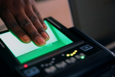 An official records finger prints of a person during voter's card registration for the country's 2019 presidential and general election, at the Independent National Electoral Commission (INEC) in Karu district in Abuja, Nigeria January 31, 2018. REUTERS/Afolabi Sotunde - RC17CD6DFB00