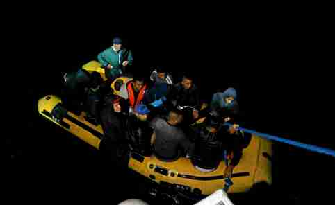 A group of Tunisian migrants arrive on a rubber boat after being rescued by the Tunisian  coast guard off the coast of Bizerte, Tunisia October 12, 2017. Picture taken October 12, 2017. REUTERS/Zoubeir Souissi - RC15BE82E6B0