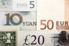 Arrangement of various world currencies including Chinese Yuan, US Dollar, Euro, British Pound, shot January 25, 2011.  REUTERS/Kacper Pempel/Illustration/File Photo  - S1AEUFNVHWAB