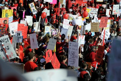 Teachers, students and members of the community hold a rally in Civic Center Park as Denver public school teachers strike for a second day in Denver, Colorado, U.S., February 12, 2019. REUTERS/Michael Ciaglo - RC1DE9397C20