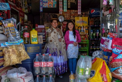 Lucia Mayta, 43, and her daughter Luz Cecilia, 12, pose for a photograph inside their bodega in La Paz February 24, 2014. Lucia studied until the fourth grade of primary school, and knows how to read and write and do basic math. Lucia runs a bodega, and the family live in a back room. She hopes to build a house in the future. Luz Cecilia is in seventh grade and wants to be a singer. On March 8 activists around the globe celebrate International Women's Day, which dates back to the beginning of the 20th century and has been observed by the United Nations since 1975. The UN writes that it is an occasion to commemorate achievements in women's rights and to call for further change. Picture taken February 24, 2014. REUTERS/David Mercado (BOLIVIA - Tags: SOCIETY EDUCATION)ATTENTION EDITORS: PICTURE 11 OF 32 FOR PACKAGE 'WOMEN'S DAY - MOTHERS AND DAUGHTERS' TO FIND ALL IMAGES SEARCH 'REUTERS MOTHERS DAUGHTERS' - GM1EA370T5701