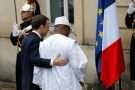 Mali's President Ibrahim Boubacar Keita is greeted by French President Emmanuel Macron as he hosts the leaders of the G5 Sahel countries - Mali, Burkina Faso, Niger, Chad and Mauritania, as well as Germany, Italy and and Saudi Arabia to discuss how to speed up the implementation of the G5 West African counter-terrorism force in La Celle Saint Cloud, near Paris, France, December 13, 2017. REUTERS/Philippe Wojazer - RC1CD5FF5400