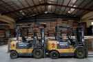 Fork-lift machines are seen idle at Dangote tomatoes processing factory along the Kano-Zaria road in Kano, northwest Nigeria August 21, 2017. Picture taken August 21, 2017. REUTERS/Akintunde Akinleye. - RC1F842D65B0