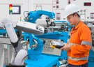 Man working in factory with heavy machinery