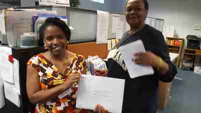 Famicos coordinators are seen mailing a packet of completed voter registration forms.
