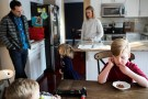 Nobel Lett (R), who suffers from Prader-Willi Syndrome and is treated under the Children's Health Insurance Program (CHIP), eats a snack with his family after school in his home in Columbus, Ohio, U.S. January 17, 2018.   REUTERS/Maddie McGarvey - RC14BB847C60
