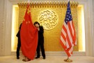 Staff members set up Chinese and U.S. flags for a meeting between Chinese Transport Minister Li Xiaopeng and U.S. Secretary of Transportation Elaine Chao at the Ministry of Transport of China in Beijing, China April 27, 2018. REUTERS/Jason Lee/Pool - RC155E3642C0