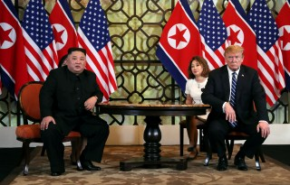 FILE PHOTO: North Korean leader Kim Jong Un and U.S. President Donald Trump listen to questions from the media during their one-on-one bilateral meeting at the second North Korea-U.S. summit in the Metropole hotel in Hanoi, Vietnam February 28, 2019. REUTERS/Leah Millis/File Photo - RC1CA46BF930