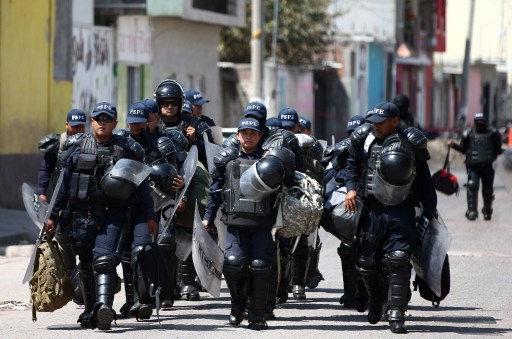 DATE IMPORTED: March 06, 2019 Police officers patrol a street after a blockade set by members of the Santa Rosa de Lima Cartel to repel security forces during an anti-fuel theft operation in Santa Rosa de Lima, in Guanajuato state, Mexico, March 6, 2019. REUTERS/Edgard Garrido