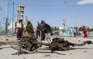 Somali women walk past the wreckage of a car involved in an explosion near the president's residence in Mogadishu, Somalia December 22, 2018. REUTERS/Feisal Omar - RC195E3B8230