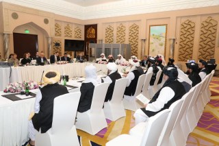 Undated handout picture of U.S., Taliban and Qatar officials during a meeting for peace talks in Doha, Qatar. Qatari Foreign Ministry/Handout via REUTERS ATTENTION EDITORS - THIS PICTURE WAS PROVIDED BY A THIRD PARTY. - RC1623E5FFE0