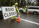 Workers keep a portion of Issaquah-Hobart Road Southeast closed to traffic as crews restore a damaged power pole in Issaquah, Washington December 10, 2015. Residents of the U.S. Pacific Northwest were hit by fresh storms on Thursday after the region received record-breaking rainfall that left two dead in Oregon and triggered widespread flooding, landslides, road closures and power cuts. REUTERS/Jason Redmond - GF10000261699