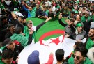 People carry a national flag during a protest to push for the removal of the current political structure, in Algiers, Algeria April 5, 2019. REUTERS/Ramzi Boudina - RC11F4580FD0
