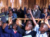 Kimani Murage, an 84-year-old Kenyan grandfather who has 30 grandchildren, attends lessons with classmates January 15, 2004 at a primary school after the government introduced free primary education last year. Murage, who was part of the Mau Mau movement that fought against British colonial rule in Kenya in the 1950s, has classmates whose average age is seven years old, and two of his grandchildren attend more advanced classes in the same school in Kenya's Eldoret district, some 270 km (162 miles) northwest of the capital Nairobi. REUTERS/Beatrice Mategwa  PP04010048 RS/ACM - RP4DRIGLUBAC