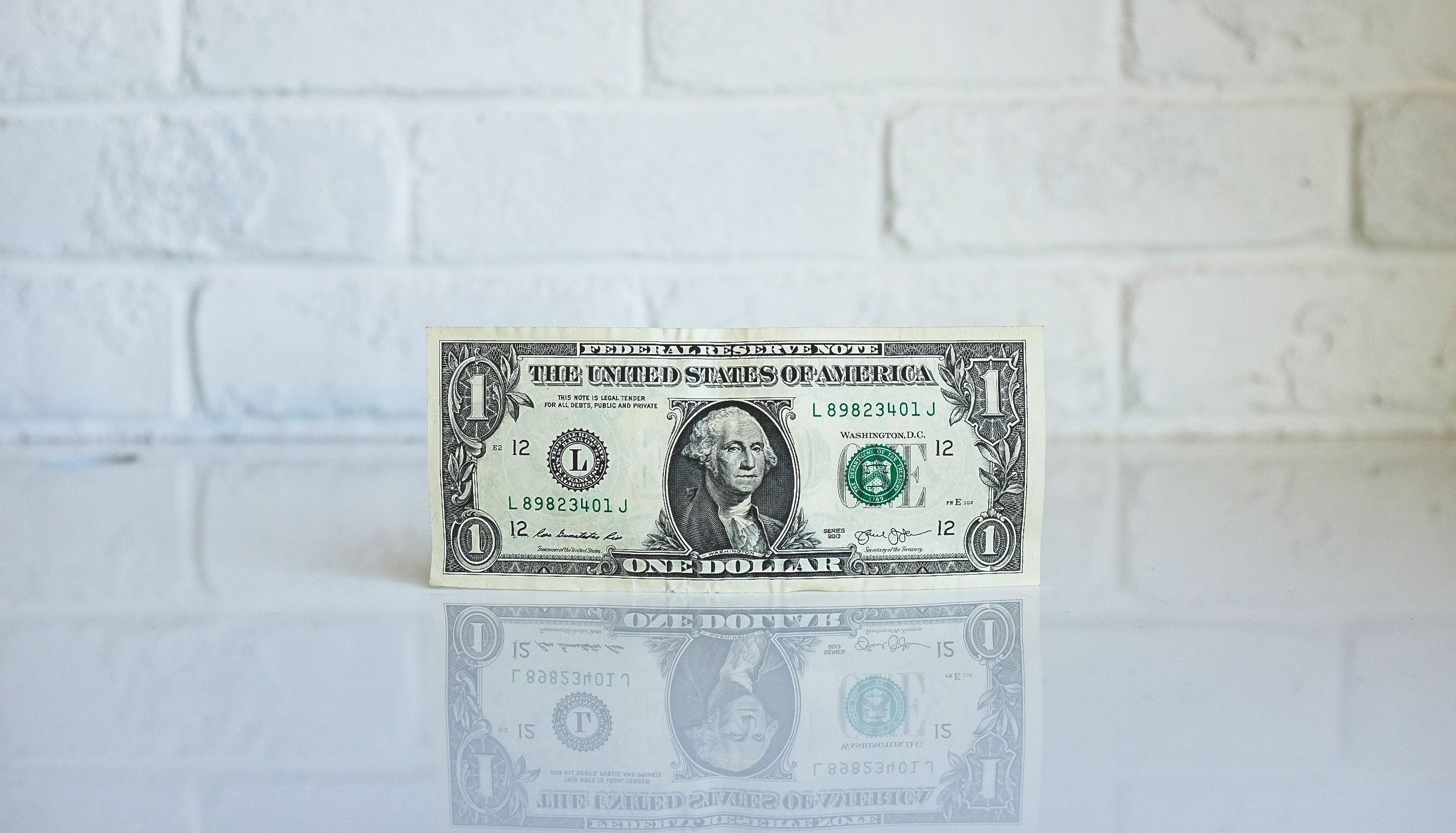 dollar bill- by neonbrand from unsplash