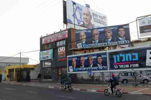 Cyclists ride past a Likud party election campaign billboard depicting Israeli Prime Minister Benjamin Netanyahu and billboards depicting Benny Gantz, leader of Blue and White party, together with his top party candidates Moshe Yaalon, Yair Lapid and Gaby Ashkenazi, in Petah Tikva, Israel April 7, 2019. REUTERS/Nir Elias - RC1711986540