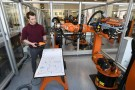 Bastian Remmel, an employee of German manufacturer of industrial robots and automation solutions KUKA, poses for pictures at the company's training center in Augsburg, Germany, March 28, 2019. REUTERS/Andreas Gebert - RC195B733B00